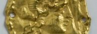 Aplique. Cabeza de Alejandro Magno. Lámina de oro. 14-54. Colonia Celsa (Velilla de Ebro, Zaragoza). Inv. 48710